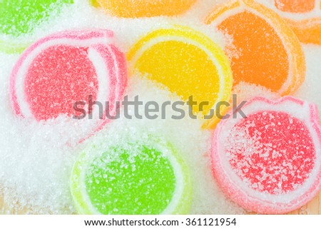 Jelly sweet, flavor fruit, candy dessert colorful on sugar. - stock photo