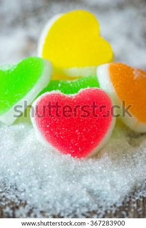 Jelly sweet, flavor fruit, candy dessert colorful on wood background. - stock photo
