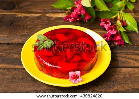 Jelly with strawberries. On a wooden rustic background. Close-up - stock photo