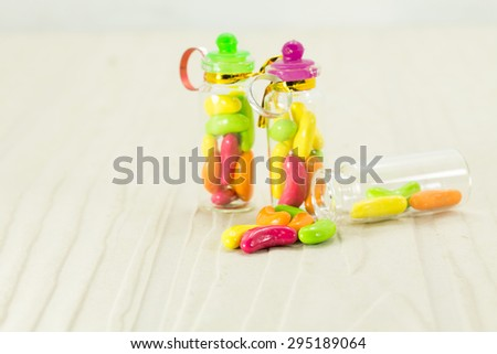 Jellybeans in a glass candy jar  and clipping path. - stock photo