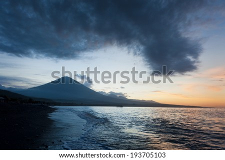 Jemeluk Beach, Amed, Bali. Located in east Bali, Indonesia, this small fishing village is fast becoming a tourist destination. The active volcano, Mt. Agung, looms large in the background.