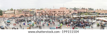 JEMMA DAR FNA, THE MAIN BAZAAR, MARRAKECH, MOROCCO, MAY 11, 2014. A Panoramic view to the people, booths and stalls in Jemma Dar Fna,  Marrakech, Morocco, on May 11th, 2014. - stock photo