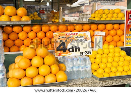 JEMMA DAR FNA, THE MAIN BAZAAR, MARRAKECH, MOROCCO, MAY 11, 2014. Fresh-squeezed orange juice for sale in a stall in Jemma Dar Fna,  Marrakech, Morocco, on May 11th, 2014.  - stock photo