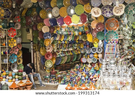 JEMMA DAR FNA, THE MAIN BAZAAR, MARRAKECH, MOROCCO, MAY 11, 2014. Plates and pots for sale in a shop in Jemma Dar Fna, Marrakech, Morocco, on May 11th, 2014.  - stock photo