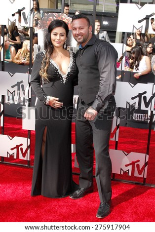 Jenni Farley and Roger Mathews at the 2014 MTV Movie Awards held at the Nokia Theatre L.A. Live in Los Angeles on April 13, 2014 in Los Angeles, California.  - stock photo