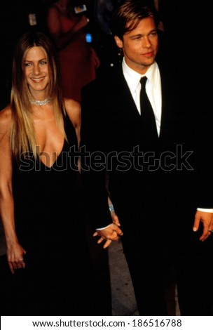 JENNIFER ANISTON and BRAD PITT, wife & husband, attend the post-Academy Awards Vanity Fair party, 3/26/00 - stock photo