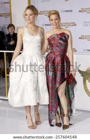 Jennifer Lawrence and Elizabeth Banks at the Los Angeles premiere of 'The Hunger Games: Mockingjay - Part 1' held at the Nokia Theatre L.A. Live on November 17, 2014 in Los Angeles, California. - stock photo