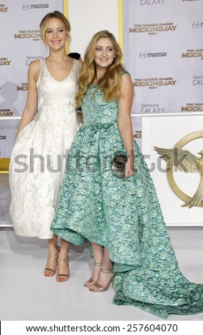Jennifer Lawrence and Willow Shields at the Los Angeles premiere of 'The Hunger Games: Mockingjay - Part 1' held at the Nokia Theatre L.A. Live on November 17, 2014 in Los Angeles, California.  - stock photo