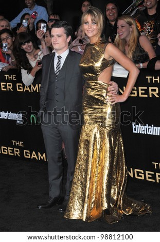 """Jennifer Lawrence & Josh Hutcherson at the world premiere of their new movie """"The Hunger Games"""" at the Nokia Theatre L.A. Live. March 12, 2012  Los Angeles, CA Picture: Paul Smith / Featureflash - stock photo"""
