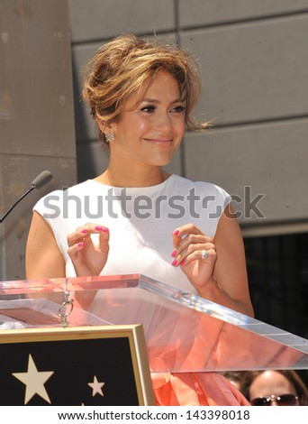 Jennifer Lopez on Hollywood Blvd where she was honored with the 2,500th star on the Hollywood Walk of Fame. June 20, 2013 Los Angeles, CA - stock photo