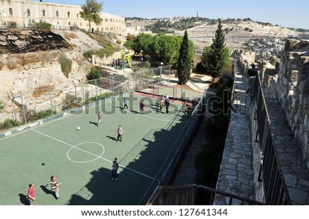 JER - NOV 05:Jewish men play soccer against Mt of Olives on November 05 2010 Jerusalem Israel.It's one of the most important holy sites in Judaism as it believed that it's where the Messiah will trod. - stock photo