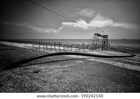 Jeran beach during low tide in black and white - stock photo