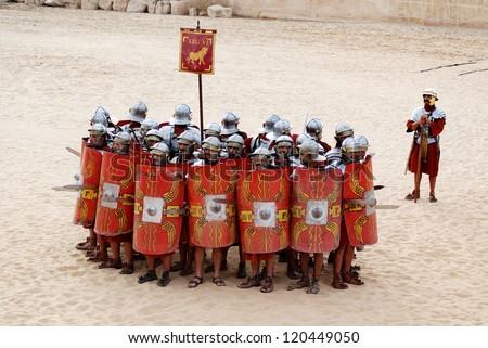JERASH - JORDAN - NOVEMBER 25: Jordanian men dress as Roman soldier during a roman army reenactment show on November 25, 2009 in Jerash, Jordan - stock photo