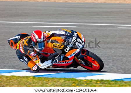 JEREZ DE LA FRONTERA, SPAIN - APR 17: 125cc motorcyclist Alex Rins takes a curve in the CEV Championship race on April 17, 2011 in Jerez de la Frontera, Spain. - stock photo
