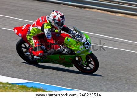 JEREZ DE LA FRONTERA, SPAIN - APR 17: 125cc motorcyclist Juanfran Guevara takes a curve in the CEV Championship race on April 17, 2011 in Jerez de la Frontera, Spain. - stock photo