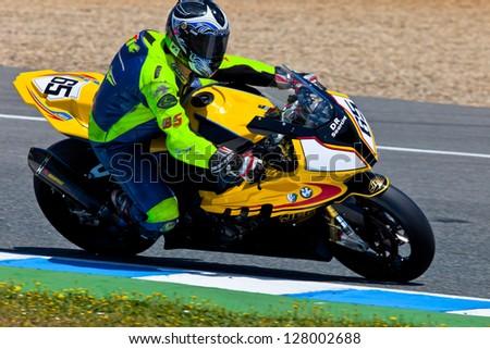 JEREZ DE LA FRONTERA, SPAIN - APR 17: Stock Extreme motorcyclist Juan Eric Gomez takes a curve in the CEV Championship race on April 17, 2011 in Jerez de la Frontera, Spain - stock photo