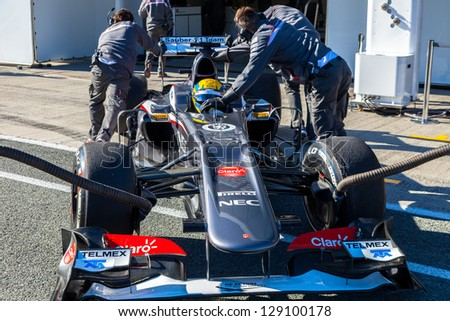 JEREZ DE LA FRONTERA, SPAIN - FEB 08: Esteban Gutierrez of Sauber F1 Team  entering to the pit on training session on February 08 , 2013, in Jerez de la Frontera , Spain - stock photo
