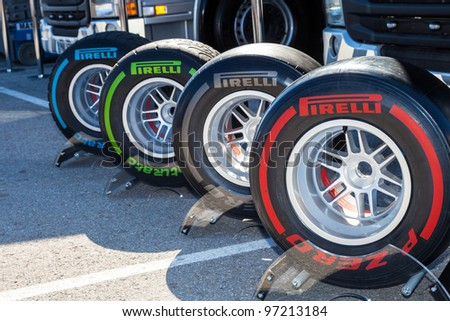 JEREZ DE LA FRONTERA, SPAIN - FEB 08: Exposition of the several sets of pneumatic tires Pirelli for the championship of Formula 1 of 2012 on February 08 , 2012, in Jerez de la Frontera , Spain - stock photo