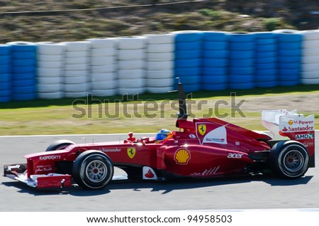 JEREZ DE LA FRONTERA, SPAIN - FEB 09: Fernando Alonso of Ferrari team drives his F1 car during training session at Jerez circuit on February 09, 2012, in Jerez de la Frontera , Spain - stock photo