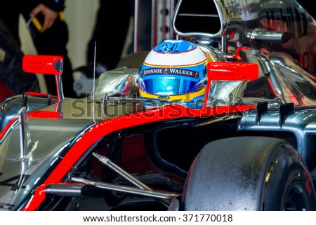 JEREZ DE LA FRONTERA, SPAIN - FEB 03:  Fernando Alonso of McLaren Honda F1 waiting on the pits on training session on February 03 , 2015, in Jerez de la Frontera , Spain - stock photo