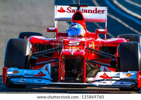 JEREZ DE LA FRONTERA, SPAIN - FEB 10: Fernando Alonso of Scuderia Ferrari F1 leaving the pit on training session on February 10 , 2012, in Jerez de la Frontera , Spain - stock photo