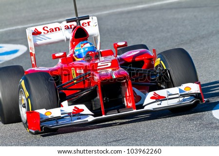 JEREZ DE LA FRONTERA, SPAIN - FEB 10: Fernando Alonso of Scuderia Ferrari F1 races on training session on February 10, 2012, in Jerez de la Frontera , Spain - stock photo