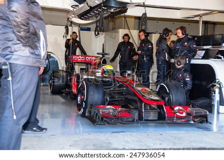 JEREZ DE LA FRONTERA, SPAIN - FEB 10: Lewis Hamilton of McLaren F1 waiting on the pit on training session on February 10 , 2012, in Jerez de la Frontera , Spain - stock photo