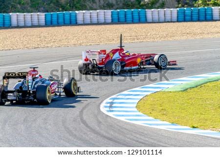 JEREZ DE LA FRONTERA, SPAIN - FEB 08: Pedro de la Rosa of Scuderia Ferrari F1 followed by Kimi Raikkonen of Lotus races on training session on February 08 , 2013, in Jerez de la Frontera , Spain - stock photo