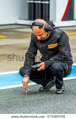 JEREZ DE LA FRONTERA, SPAIN - FEB 03: Pirelli engineer on pits on training session on February 03, 2015 in Jerez de la Frontera , Spain - stock photo