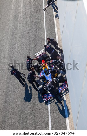 JEREZ DE LA FRONTERA, SPAIN - FEB 10: Sebastian Vettel of Red Bull F1 entering to the pit on training session on February 10 , 2012, in Jerez de la Frontera , Spain - stock photo