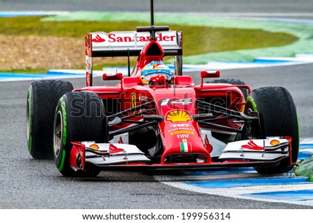 JEREZ DE LA FRONTERA, SPAIN - JAN 31: Fernando Alonso of Scuderia Ferrari F1 races on training session on January 31 , 2014, in Jerez de la Frontera , Spain - stock photo