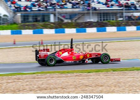 JEREZ DE LA FRONTERA, SPAIN - JAN 31: Fernando Alonso of Scuderia Ferrari F1 races on training session on January 31 , 2014, in Jerez de la Frontera , Spain - stock photo