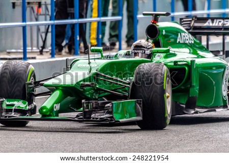 JEREZ DE LA FRONTERA, SPAIN - JAN 31: Kamui Kobayashi of Caterham F1 leaving the pit on training session on January 31 , 2014, in Jerez de la Frontera, Spain - stock photo