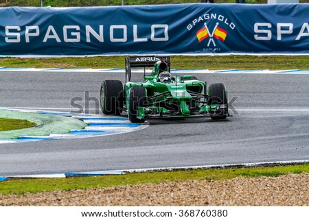 JEREZ DE LA FRONTERA, SPAIN - JAN 31: Kamui Kobayashi of Caterham F1 races on training session on January 31 , 2014, in Jerez de la Frontera , Spain - stock photo