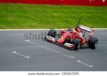 JEREZ DE LA FRONTERA, SPAIN - JAN 28: Kimi Raikkonen of Scuderia Ferrari F1 races on training session on January 28 , 2014, in Jerez de la Frontera , Spain - stock photo