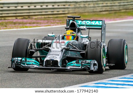 JEREZ DE LA FRONTERA, SPAIN - JAN 31:  Lewis Hamilton of Mercedes F1 races on training session on January 31 , 2014, in Jerez de la Frontera , Spain - stock photo
