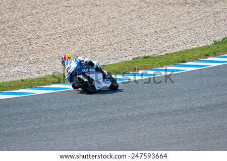 JEREZ DE LA FRONTERA, SPAIN - MAR 5: Moto2 motorcyclist Maverick Vinales takes a curve in the MotoGP Official Trainnig on Mar 5, 2011 in Jerez de la Frontera, Spain - stock photo