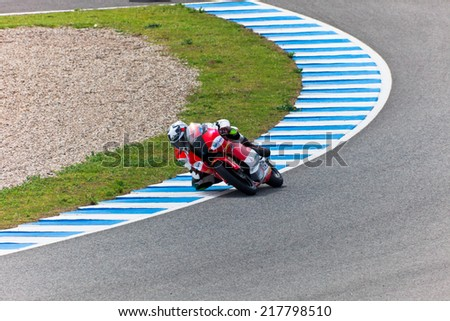JEREZ DE LA FRONTERA, SPAIN - MAR 5: Moto2 motorcyclist Miguel Oliveira takes a curve in the MotoGP Official Trainnig on Mar 5, 2011 in Jerez de la Frontera, Spain - stock photo