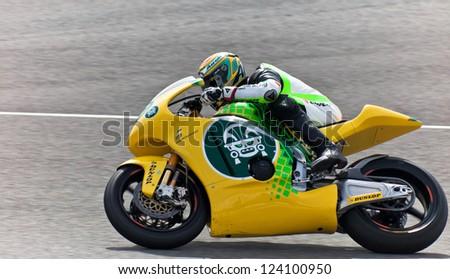 JEREZ DE LA FRONTERA, SPAIN - MAR 5: Moto2 motorcyclist Simone Corsi races in the MotoGP Official Trainnig on Mar 5, 2011 in Jerez de la Frontera, Spain - stock photo