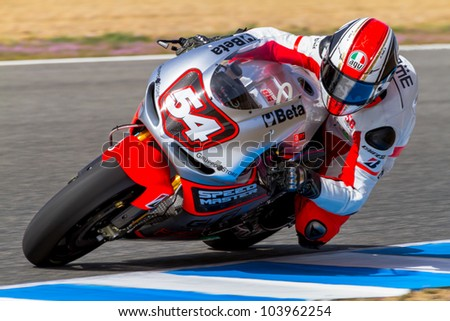 JEREZ DE LA FRONTERA, SPAIN - MAR 23: MotoGP motorcyclist Mattia Pasini takes a curve in the MotoGP Official Trainnig on March 23, 2012 in Jerez de la Frontera, Spain - stock photo