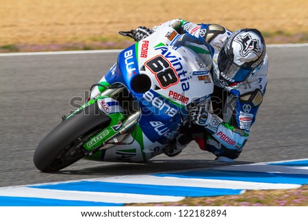 JEREZ DE LA FRONTERA, SPAIN - MAR 23: MotoGP motorcyclist Yonny Hernandez takes a curve in the MotoGP Official Trainnig on March 23, 2012 in Jerez de la Frontera, Spain - stock photo