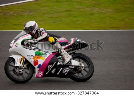JEREZ DE LA FRONTERA, SPAIN - NOV 20: 125cc motorcyclist Miguel Poyatos Alarcon races in the CEV championship on Nov 20, 2010, in Jerez de la Frontera, Spain - stock photo