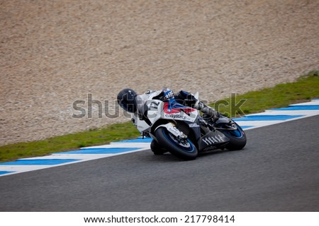 JEREZ DE LA FRONTERA, SPAIN - NOV 20: Stock Extreme motorcyclist Javier Pascual takes a curve in the CEV championship on Nov 20, 2010, in Jerez de la Frontera, Spain - stock photo