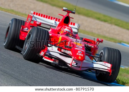 JEREZ DE LA FRONTERA, SPAIN - OCT 11: Michael Schumacher of Scuderia Ferrari F1 races on training session on October 11 , 2006 in Jerez de la Frontera , Spain - stock photo