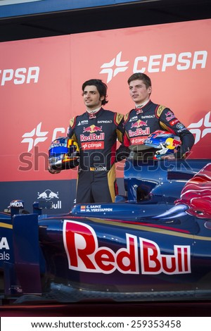 JEREZ, SPAIN - FEBRUARY 2ND: Max Verstappen & Carlos Sainz presenting their new ST10 Scuderia Toro Rosso F1 car on the first Test at the Jerez Circuit in Jerez, Andalucia, Spain on Feb. 2, 2015. - stock photo