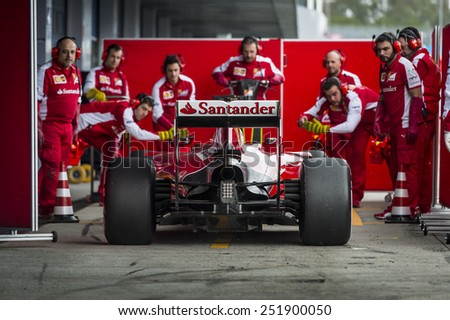 JEREZ, SPAIN - FEBRUARY 2ND: Sebastian Vettel testing his new Ferrari SF15-T F1 car on the first Test at the Jerez Circuit in Jerez, Andalucia, Spain on Feb. 2, 2015. - stock photo