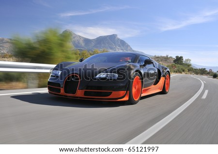 JEREZ, SPAIN - SEPTEMBER 19: The Bugatti Veyron Super Sport the World's Fastest Production Car on show and driven on September 19, 2010, on the mountain roads around Jerez, Spain, organized by Bugatti. - stock photo