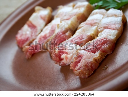 Jerked meat .uncooked dried pork belly sliced