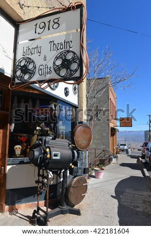 JEROME, AZ, USA - FEB 24, 2016:  The historic Liberty Theater on Jerome Ave, now a museum and gift shop, featuring an old fashioned projector.  Jerome is a national historic landmark. - stock photo