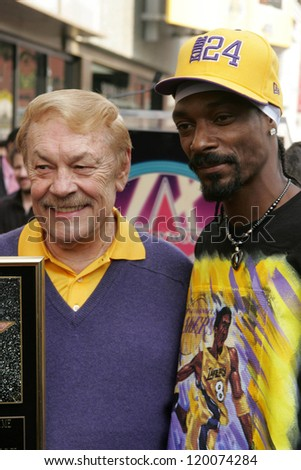 Jerry Buss and Snoop Dogg at the Ceremony Honoring Los Angeles Lakers Owner Jerry Buss with the 2,323rd star on the Hollywood Walk of Fame. Hollywood Boulevard, Hollywood, CA. 10-30-06 - stock photo